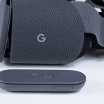 Google Daydream View headset with controller in front of it.