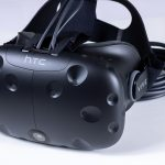 Front view of the HTC Vive VR headset with cables and head-strap.