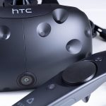 HTC Vive headset and controller in front.