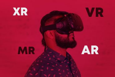 Man wearing VR headset with words, XR, VR, MR and AR around him.