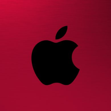 Apple AR VR Headset - Apple logo on a red, brushed metal background.
